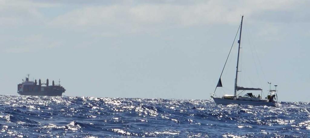 container ship kwailin and sailing yacht oda
